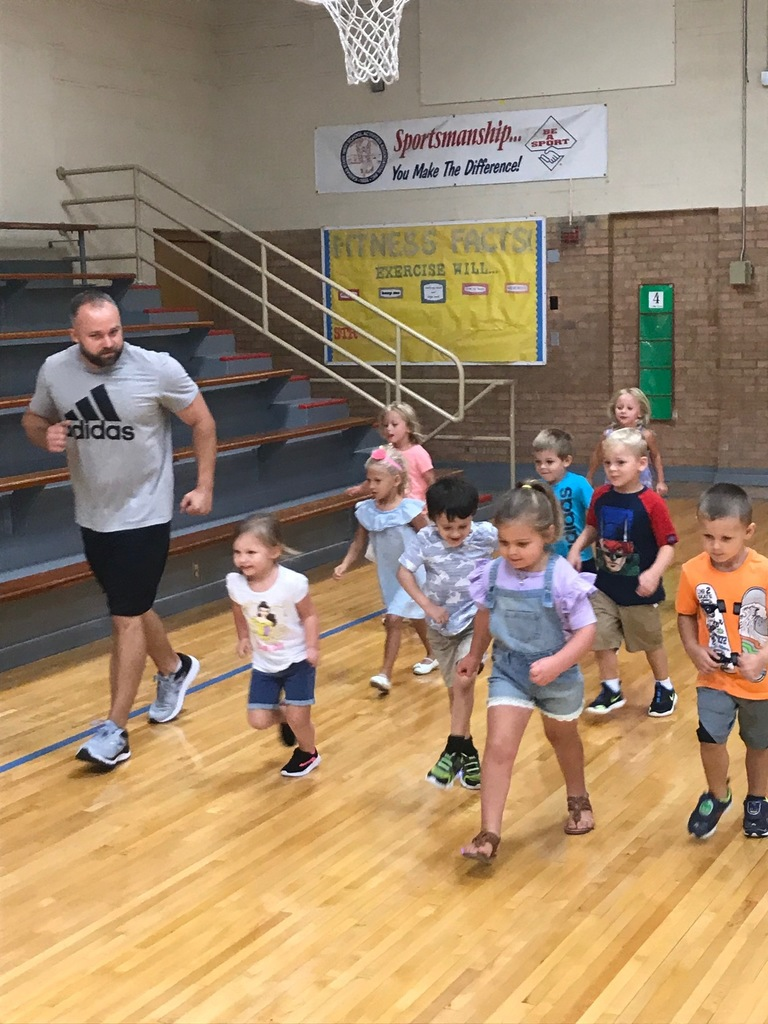 Mr. Ediger running with Pre-K